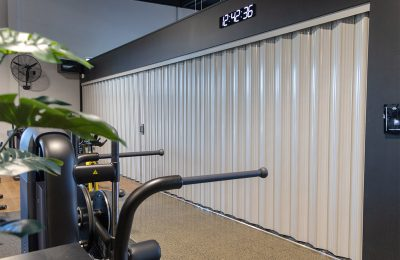 "DuraFlex model Won-Door forms a privacy and sight barrier to separate a group session training room from the rest of the gym. Robyn, Manager of Flex Fitness Pukekohe had just three words when asked about the Won-Door – ""They look great!"""